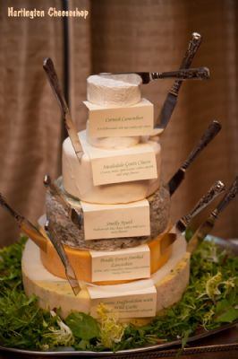 Cheese wedding cake styled with cheese knives