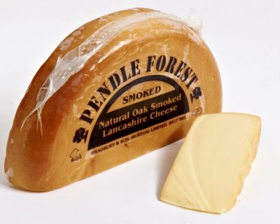 Produced at Sandhams dairy in Barton this is a traditional hard pressed Lancashire cheese. Naturally oak smoked in Sandhams own smoke house the cheese has a creamy texture of Lancashire combined with a sharp smoked taste. Cheese