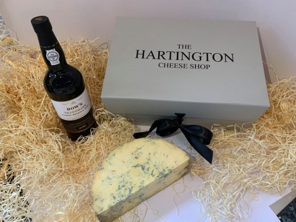 <p>A bottle of port (Cockburns or other well known label) and half a creamy Hartington Blue Stilton made in Derbyshire.</p>