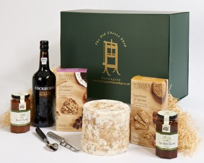 <p>whole mini stilton' 75cl bottle of Cockburn' a cheese knife and two chutneys - Sweet Apple and Apricot' Millers Toasts (Cranberry & Raisin and Pecan & Hazelnut).</p>